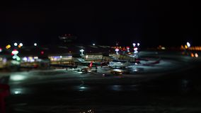 Timelapse of maintaining and boarding planes. Vnukovo Airport at winter night stock video footage