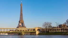 Timelapse of Metro crossing Passy bridge. With Eiffel Tower in background - Paris, France stock video