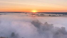 Timelapse mist curling over river and meadow on sunrise background.  stock video