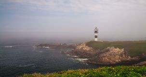 Timelapse of misty day at Ribadeo Lighthouse, Galicia, Spain stock video footage