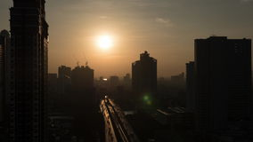 Timelapse of morning changing night in Bangkok, Thailand. Timelapse shot of dawn in Bangkok, Thailand. Sun rising in the sky over the capital. Cityscape with stock video