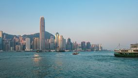 Timelapse of morning in Hong Kong Victoria Harbour with ferry in China stock video footage