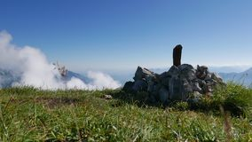 Timelapse on a mountain with clouds rushing by stock video footage