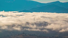 Timelapse, a mountain village in the oxen of fog in autumn in the Carpathian's stock video