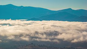 Timelapse, a mountain village in the oxen of fog in autumn in the Carpathians stock video