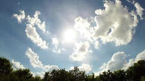Timelapse video of sun and clouds stock footage