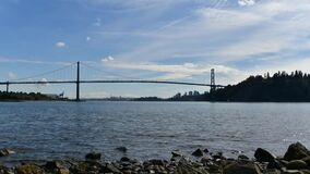 A timelapse movie of the Lion`s Gate Bridge and the ocean at day time.   Narrow Ver.