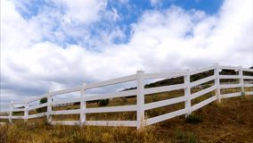 Timelapse Movie of White Fence of Leading Lines in the Country stock footage