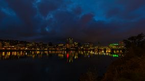 Timelapse of moving clouds over Portland Oregon downtown city skyline with Hawthorne Bridge and water reflection 4k stock footage