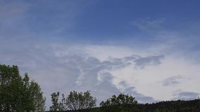 Timelapse of moving clouds in Pyrenees, France stock footage