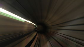 Timelapse of moving through subway tunnels. Timelapse shot of traveling through the underground tunnels, view from the cab. Train making stops and and arriving stock footage