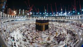Muslim pilgrims at the entrance of Quba mosque in Medina,Zoom in timelapse of Muslim pilgrims circumambulate the Kaaba in Mecca, S stock footage