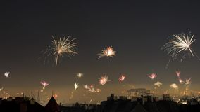 Timelapse of New Year`s Eve fireworks in midnight sky over Vienna, Austria stock video footage