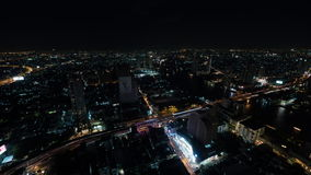 Timelapse of night Bangkok, panorama of illuminated city. Timelapse shot of night life in Bangkok, Thailand. Panoramic view of illuminated metropolis with car stock video