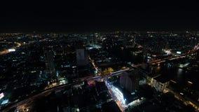 Timelapse of night Bangkok, panorama of illuminated city. Timelapse shot of night life in Bangkok, Thailand. Panoramic view of illuminated metropolis with car stock video