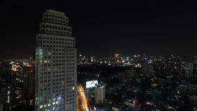 Timelapse of night city of Bangkok, Thailand. Timelapse shot of Bangkok at night, Thailand. Big illuminated city with transport traffic and high-rise building in stock footage