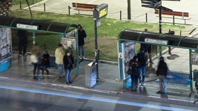 Timelapse of night city with the bus stop, where expect the transport people stock footage