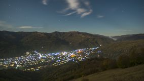 Timelapse night city among the mountains in the fog stock video footage