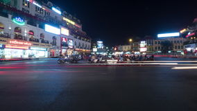 Timelapse of night city Quang truong Kinh Nghia Thuc, seen busy road with passing cars, motorcycles and cyclists stock video