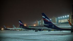 Timelapse of night flights service at Sheremetyevo Airport in Moscow, Russia. MOSCOW, RUSSIA - JANUARY 29, 2018: Timelapse shot of maintaining Aeroflot planes stock footage