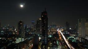 Timelapse of night illuminated Bangkok. Timelapse shot of the moon rising in night Bangkok. Night cityscape of Thailand capital. View to the illuminated stock video