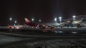 Timelapse of night routine in Vnukovo Airport. Moscow, Russia. MOSCOW, RUSSIA - DECEMBER 25, 2017: Timelapse night winter shot of special vehicles traffic and stock video footage