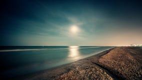 Timelapse. Night seascape landscape with full moon on sand beach. Rimini. 4K stock footage