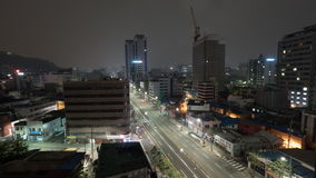 Timelapse of night Seoul with cars on motorway, South Korea. Timelapse shot of metropolis at night. Cityscape with cars driving on highway. Seoul, Republic of stock footage