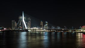 Timelapse night shot of traffic on the Erasmus Bridge, Rotterdam. Timelapse shot of car and boat traffic of the Erasmus Bridge at night. Rotterdam waterside view stock video