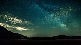 Timelapse night sky stars and milky way on mountains background stock footage