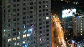 Timelapse of night traffic in Bangkok, Thailand. Timelapse shot of car traffic in night city with multistorey building in foreground. Bangkok, Thailand stock video