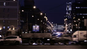 Timelapse of night traffic in Moscow. MOSCOW, RUSSIA - DECEMBER 12, 2013: Timelapse of city traffic at night on Academician Sakharov Prospect stock video footage