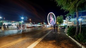 Timelapse Night Urban street view in Rimini, Italy. Summer night Urban street view in Rimini, Italy with Ferris wheel in background stock video