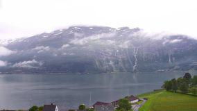 Timelapse. Norwegian Loftus. Landscape view of the falls and the movement of the clouds. stock footage