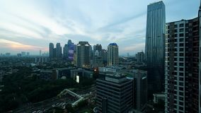 Timelapse of office buildings at sunset in Jakarta. JAKARTA - Indonesia. January 23, 2018: Aerial timelapse footage of office buildings at sunset time with stock footage