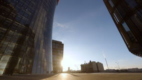 Timelapse office tower, with people passing by stock footage