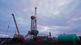 Timelapse oil drilling rig evening stock video