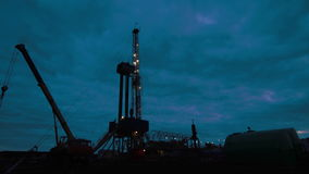 Timelapse oil drilling rig night stock footage