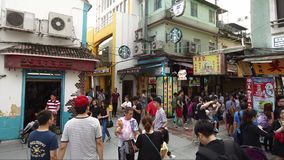 Timelapse in Old Taipa, Macau with Starbucks. Timelapse of a pedestrian intersection with Starbucks at Taipa Village (Old Taipa), Macau in China stock video