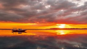 Timelapse orange sunset on the background Boat on the Beach of Gili Meno, Indonesia. 4K Timelapse in Gili Island, indonesia stock video footage