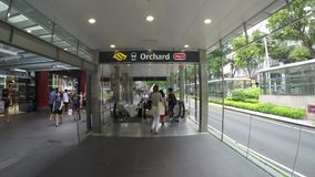 Timelapse Orchard MRT Entrance. SINGAPORE - 1 APRIL 2017: Timelapse footage of Orchard road MRT station entrance. Orchard road is the retail and entertainment stock footage