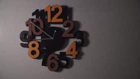 Timelapse of original wall clock with different color numbers and silver clock hands. Timelapse of original wall clock with different color numbers and silver stock footage