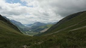 Timelapse over glen etive with hikers in foreground stock video