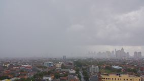 Timelapse panorama of the city of Jakarta in rainy weather. Indonesia.