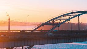 Timelapse panorama of transport on the bridge and sunrise over the Belaya River in Ufa, Bashkiria, Russia. Beautiful panorama of transport on the bridge and stock video
