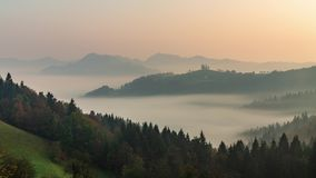 Timelapse panoramic foggy landscape at dawn over mountain and valley. Slovenia. Dancing fog