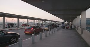 Timelapse of passengers arriving with cars to the terminal at the airport. Timelapse of passengers arriving to the departures terminal at the airport stock video