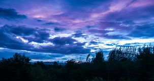 Timelapse of passing clouds over tree and mountain at twilight. Until dark ,Thailand stock video