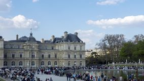 Timelapse: People enjoying sunshine in the Luxembourg garden on Sunday - Paris stock video footage