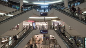 Timelapse of people on escalators in shopping centre. Timelapse shot of people riding up and down escalators in modern multistorey trade centre stock video